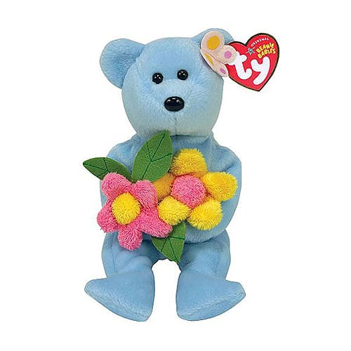 Ty bear carrying flowers